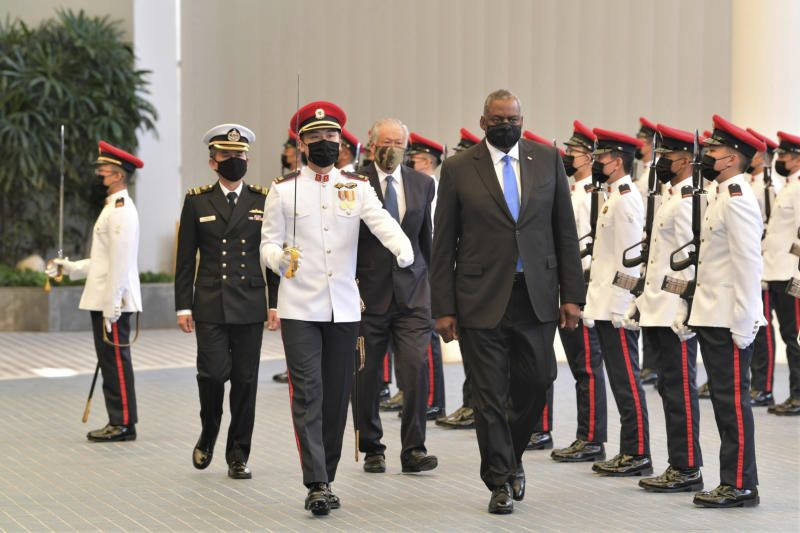 US Defence Secretary Lloyd J. Austin along with Singapore Defense Minister Ng Eng Hen (at the back) review an honor guard at the Ministry of Defense Tuesday, July 27, 2021 in Singapore. - AP