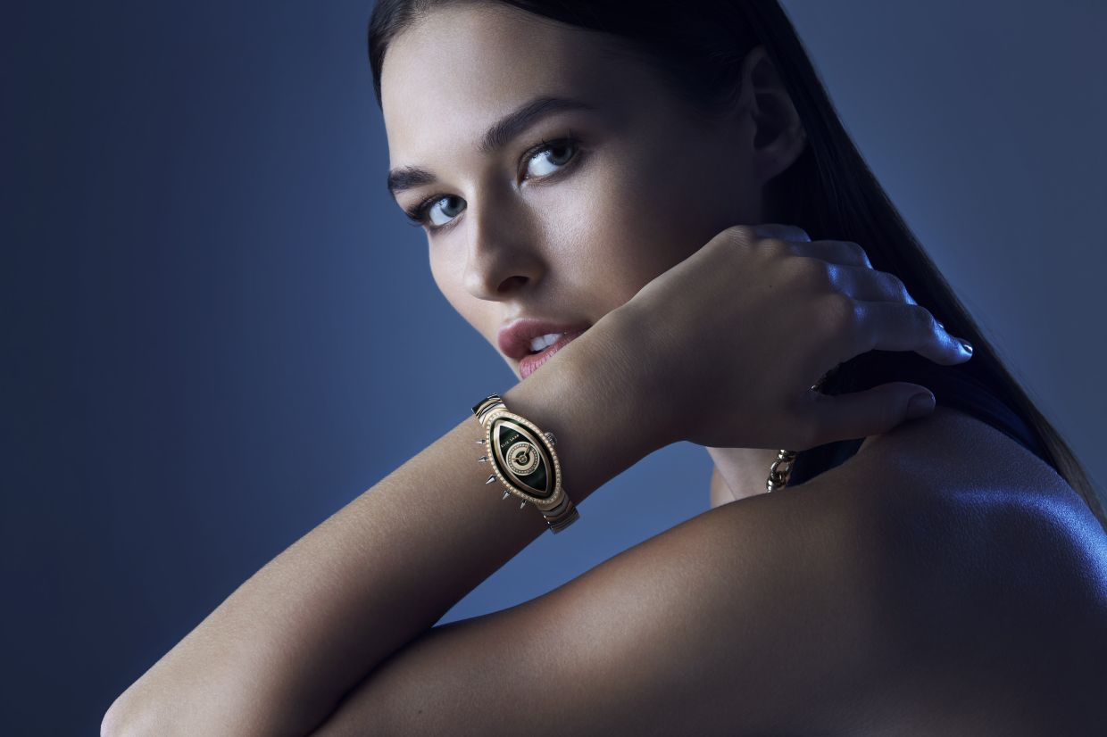 Eayan by Elie Saab, a family of five unique watches featuring an eye-shaped face and spiked embellishment. — Elie Saab