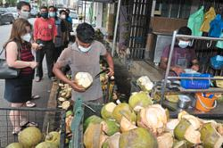 Flocking to coconut stalls to stay hydrated