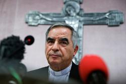 Accused cardinal in court as Vatican fraud trial opens and is adjourned