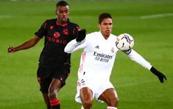 Soccer-Man United agree deal to sign Real centre back Varane