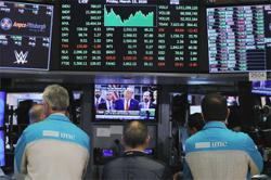 Wall St snaps five-day up streak as caution rises before tech earnings, Fed