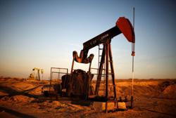 Oil prices steady as virus spread counters tight supplies