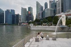 Singapore central bank removes caps on dividend payments by local banks