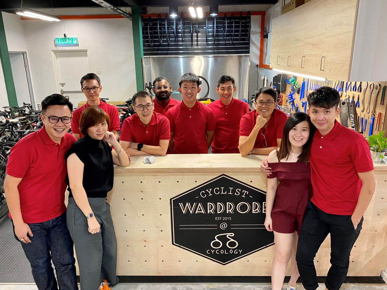 Cyclist Wardrobe founder Max Ng (extreme left) and Cycologist founder Daniel Yap (third from right) with their team.