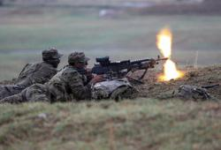Georgia, U.S. troops hold joint NATO drills in wet conditions near Tbilisi