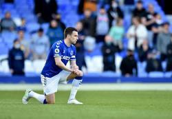 Soccer-Everton captain Coleman signs new deal until 2023