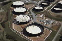Oil settles up near $75; sharp U.S. inventory drop counters virus worry