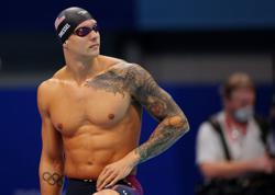 Olympics-Swimming-American Dressel wins men's 100m freestyle gold