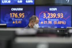 Asian markets advance after Fed meeting, Hong Kong rebounds
