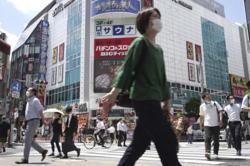 Japan Covid-19 adviser urges clear risk message as cases surge