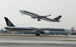 Singapore Airlines first-quarter loss narrows on cargo demand boost
