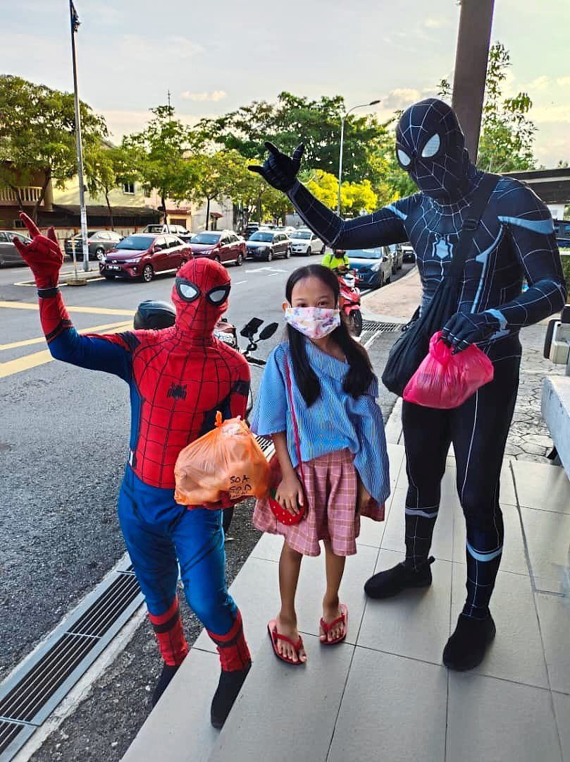 Children are thrilled to receive satay specially delivered by their favourite masked superheroes.