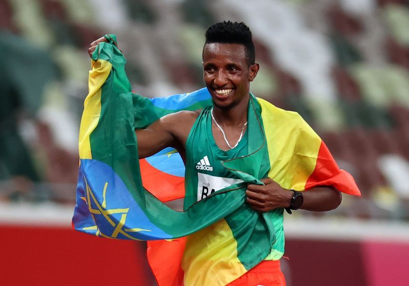 Athletics: Olympics-Athletics-Shock 10,000m winner, DQ for U.S. in mixed relay on opening night