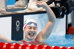 Dressel wins blue riband gold but Chinese women rule pool