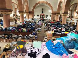 'Like back in Syria': migrant volunteers clear up flood-hit Germany