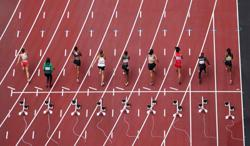 Olympics-Athletics-Women's 100m prelim heats kick off Tokyo track and field