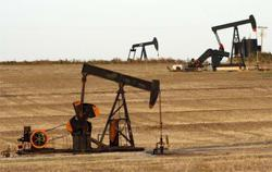 Oil prices drop, but on track for weekly gain