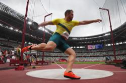 Olympics-Athletics-Denny finds his way back to qualify for discus final