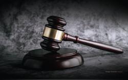 Duo including ex-govt dept head claim trial to false claim charge