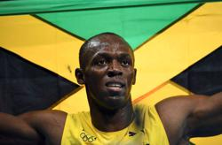 Olympics-Athletics-Bolt sees only tough times in Tokyo for Jamaica's men