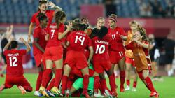 Olympics-Soccer-U.S. and Canada set up semi-final date with shootout wins