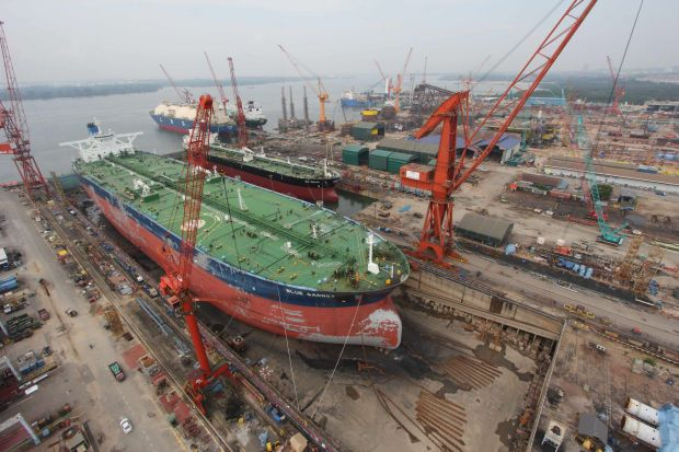 In a bourse filing yesterday, MMHE said its revenue rose to RM302.45mil from RM155.31mil a year ago. Its net losses narrowed to RM34.38mil from RM397.02mil a year ago. (File pic shows a MMHE dry dock.)