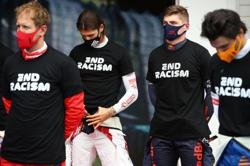 Motor racing-Red Bull split with F1 team member over racist texts