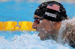 Olympics-Swimming-More gold for Dressel, McKeown does backstroke double