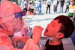 Two more parts of China report Covid-19 outbreaks; local cases increasing