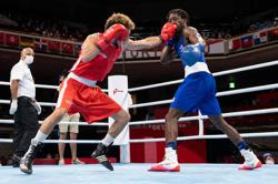 Olympics-Boxing-Mental health issues overcome, it's 'gold, gold, gold' for Davis