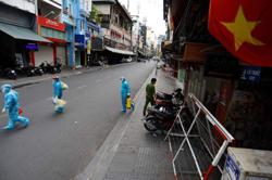 Vietnam taps private hospitals as Delta-driven Covid-19 infections rise
