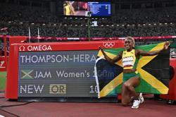 Olympics-Athletics-Thompson-Herah scorches to 100m glory, closes on Flo-Jo