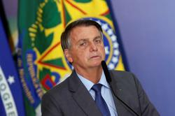 Brazil's Bolsonaro says oil company Petrobras will pay for free LPG