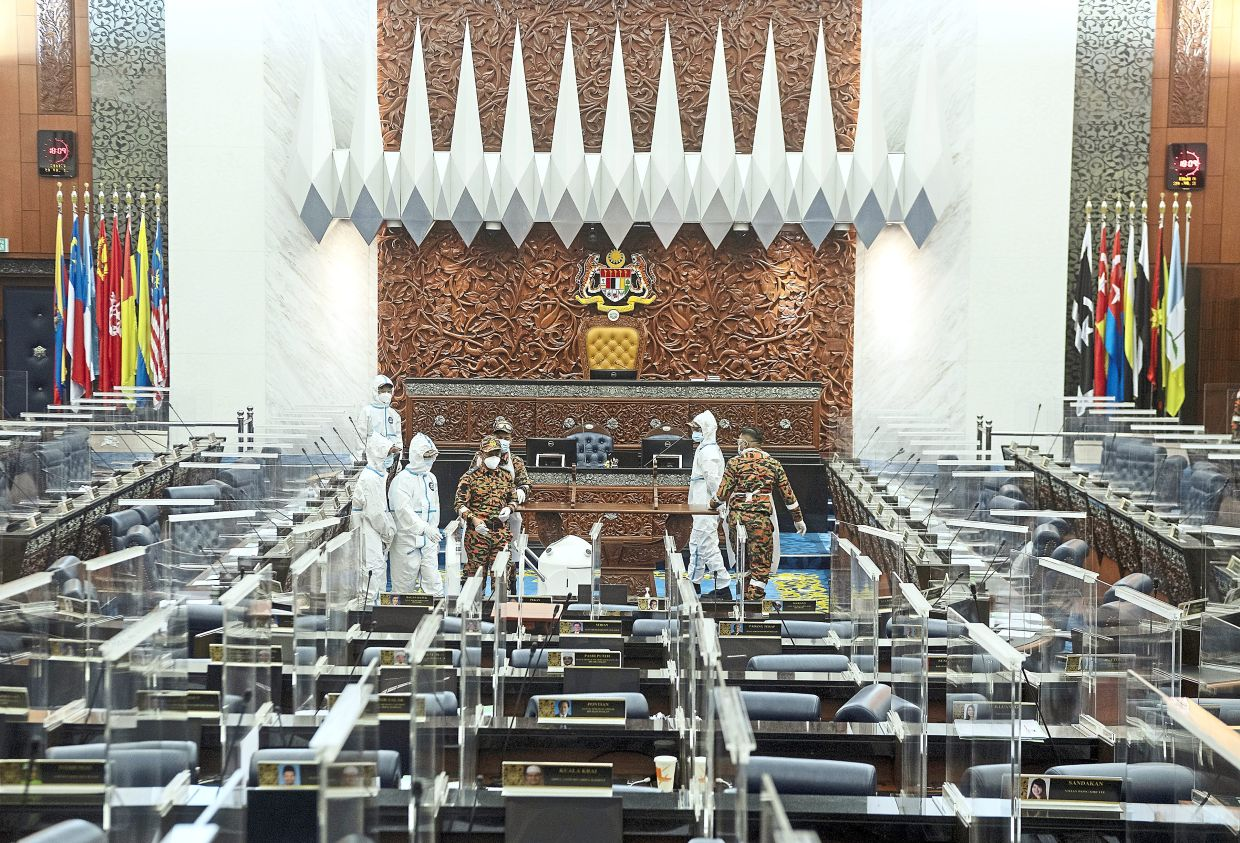 Disinfection in progress: The Dewan Rakyat being sanitised after Covid-19 positive cases were reported. — Bernama