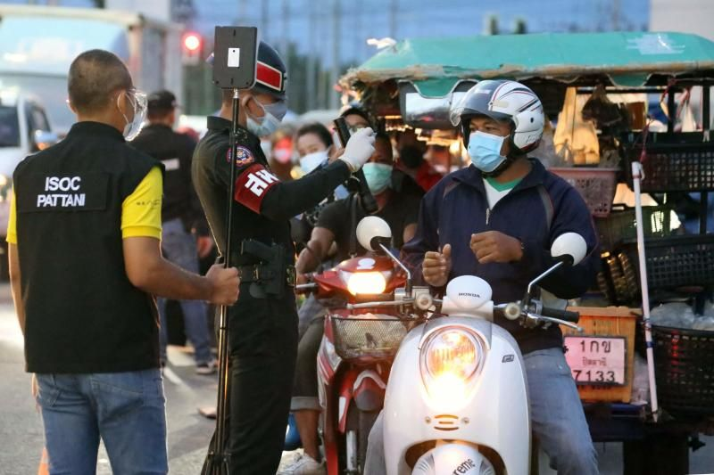 Thai military police and Pattani Port Authority officials man a checkpoint at the Pattani Port on Saturday (July 31, 2021), amid movement restrictions due to soaring coronavirus cases in the country. - AFP