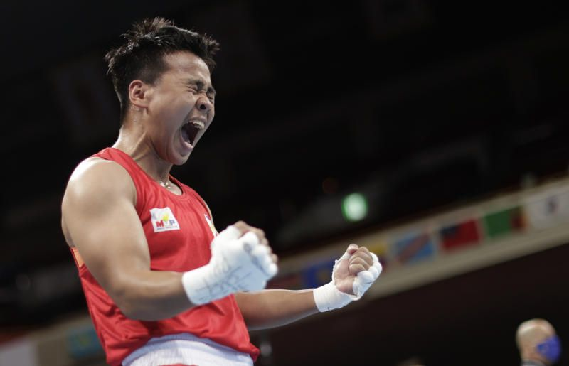 Nesthy Petecio of the Philippines reacts after winning her fight against Irma Testa of Italy during the Women's Featherweight semifinal at the KKG Kokugikan Arena during the Tokyo 2020 Olympic Games on Saturday (July 31, 2020). - Reuters