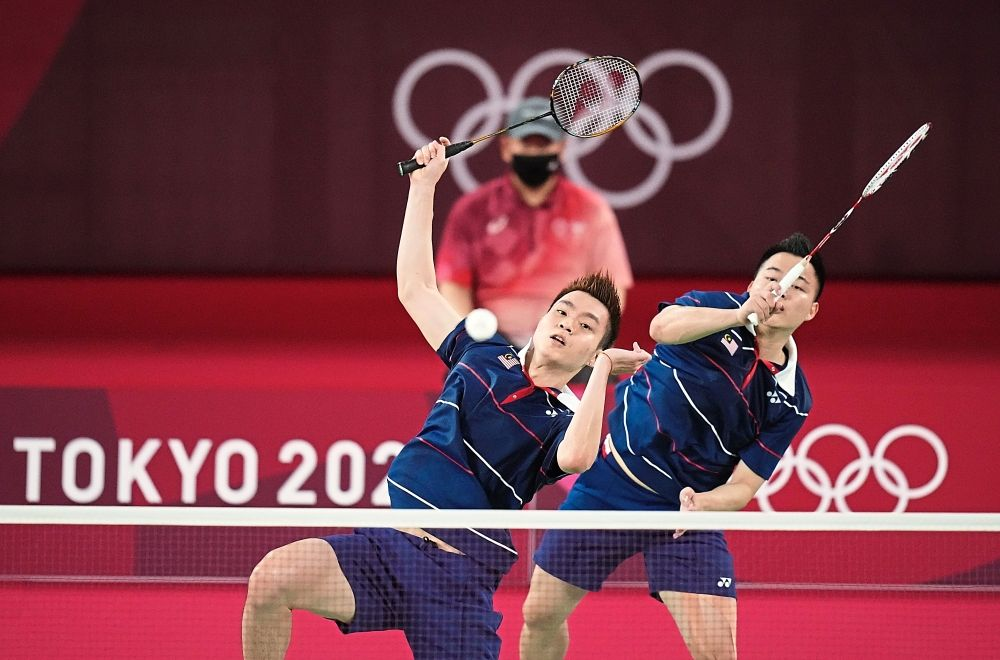 Smashing victory: Malaysia finally landed its first medal in the Tokyo Olympic Games thanks to men's doubles shuttlers Aaron Chia (right) and Soh Wooi Yik. The duo made a spectacular comeback after dropping the first game to beat world champions Mohammad Ahsan-Hendra Setiawan of Indonesia 17-21, 21-17, 21-14 in the bronzemedal playoff.