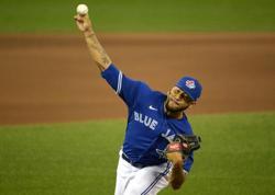Olympics-Baseball-U.S. pitcher woke to 2 a.m. call of trade to Twins