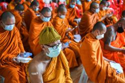 Thai monks don protective gear as Covid-19 cases surge in country