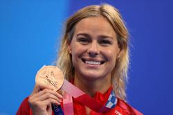 Olympics-Swimming-Medals in minutes for sprint couple Blume and Manaudou