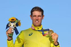 Olympics-Sailing-Choosing sailing over 'footy' pays off for Australian Wearns