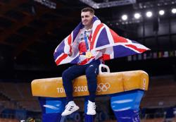 Olympics-Gymnastics-Retaining title is draining but Whitlock has more in tank