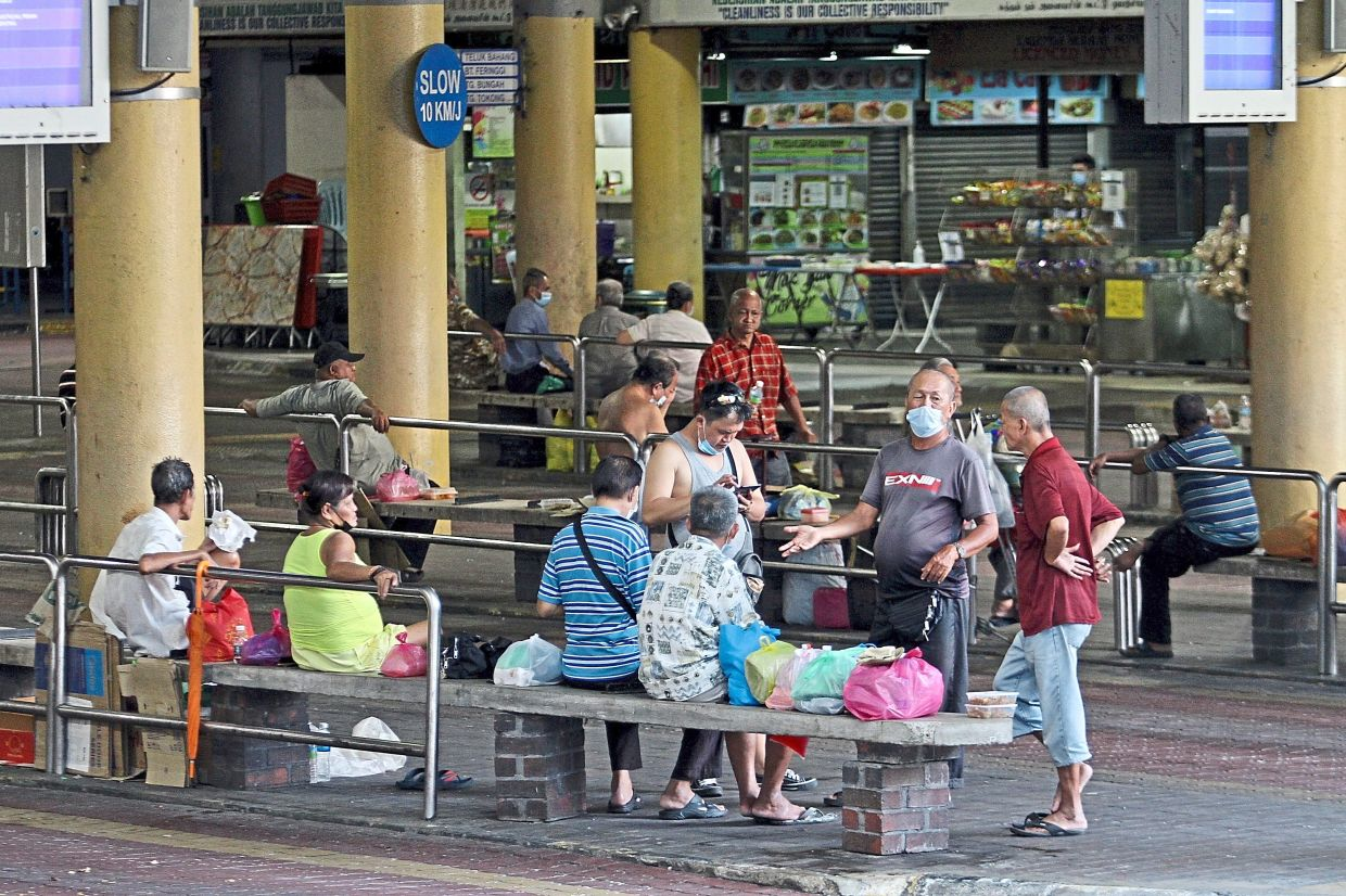 Vagrants hanging around at the Komtar bus terminal in George Town, Penang. — CHAN BOON KAI/The Star