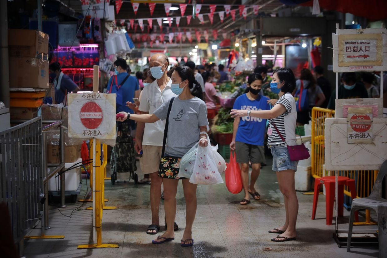 People checking out with TraceTogether at Jurong West 505 Market and Food Centre on Aug 1, 2021. - The Straits Times/ANN