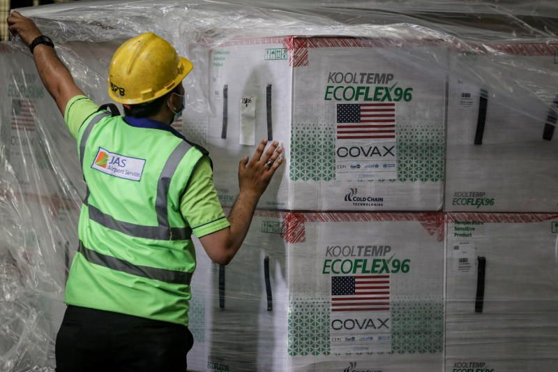 A worker unloads boxes of Covid-19 Moderna vaccine against the coronavirus disease at the Soekarno Hatta Airport in Tangerang, on the outskirts of Jakarta, Indonesia August 1, 2021, in this photo taken by Antara Foto via Reuters.