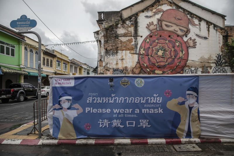 A sign asking people to wear masks in Phuket, Thailand, on Sunday, Aug. 1, 2021. Authorities in Phuket, the first Thai tourist destination to waive quarantine for vaccinated foreign visitors, will ban all domestic travelers and vehicles from entering the island for two weeks starting from Aug. 3 to reduce local infections. The measures won't affect the so-called Phuket Sandbox program, launched as a pilot project to pave the way for a wider reopening, officials said. - Bloomberg