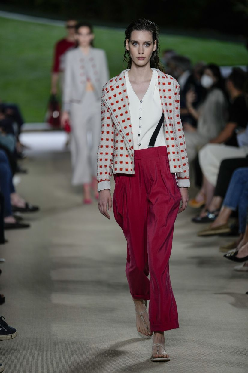 A model in a pop of red as part of the Giorgio Armani Spring/Summer 2022 collection.