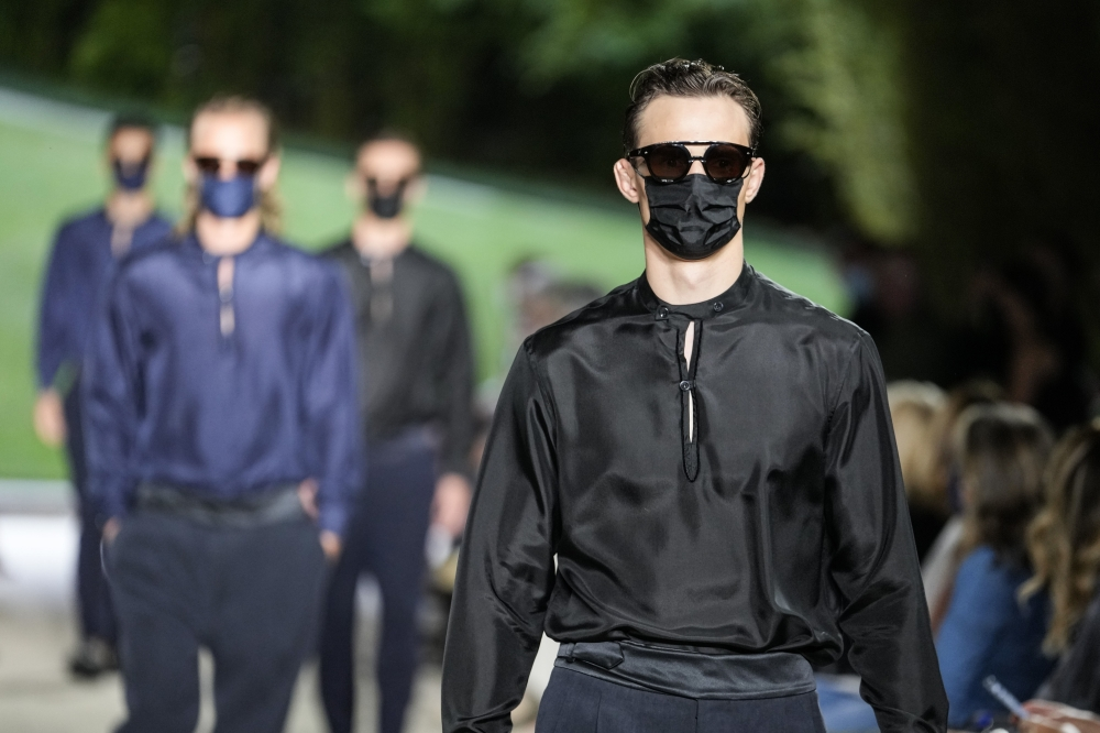 Armani closed the collection with more sombre silky looks and a handful of models wearing masks.