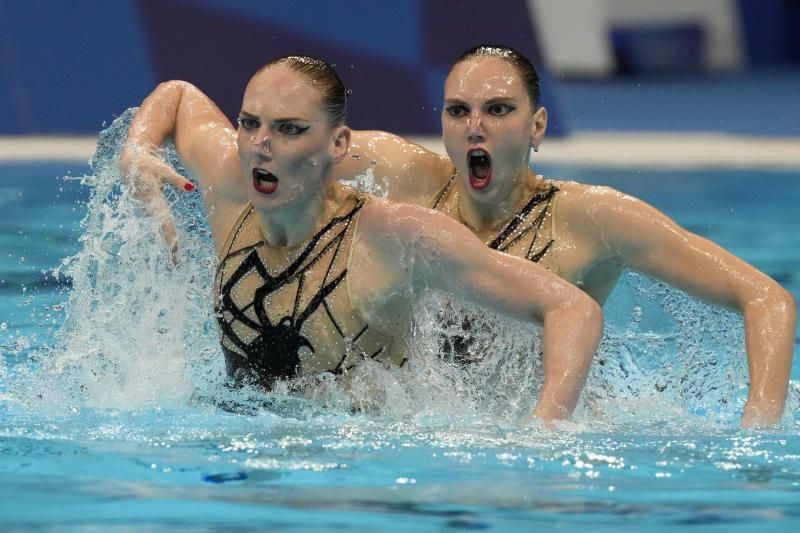 Svetlana Kolesnichenko and Svetlana Romashina of Russian Olympic Committee compete in the Duet Free Routine Preliminary at the Tokyo Aquatics Centre at the 2020 Tokyo Summer Olympics, Monday (Aug. 2, 2021). - AP